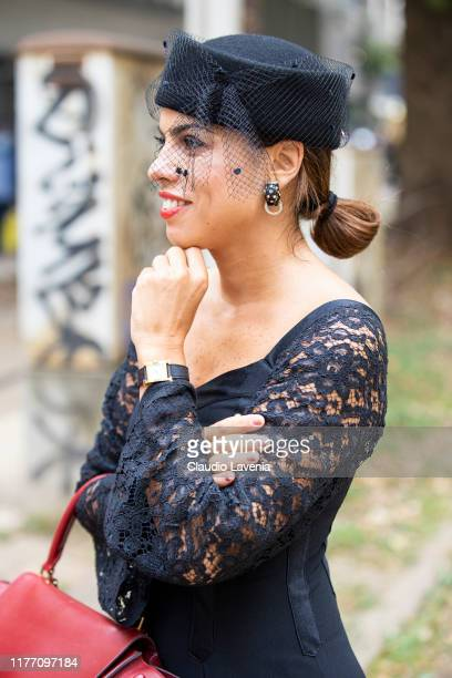 Agus Cattaneo, wearing a black midi dress and black hat, is seen outside the Dolce e Gabbana show during Milan Fashion Week Spring/Summer 2020 on...