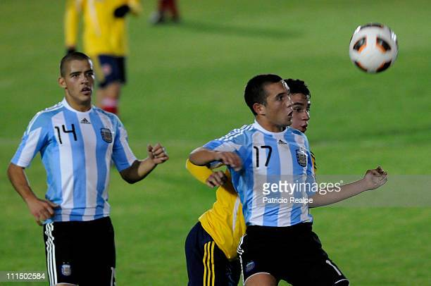 Agustin Allione and Alexis Zarate of Argentina struggles for the ball with Ricardo Araujo of Colombia during a match as part of the 2011 Sudamericano...