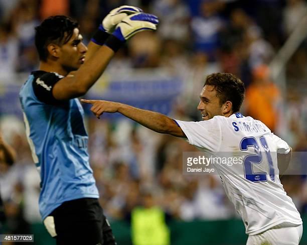 Agustin Allione of Velez Sarsfield celebrates after scoring the fourth goal as Fernando Monetti of Gimnasia y Esgrima La Plata reacts during a match...
