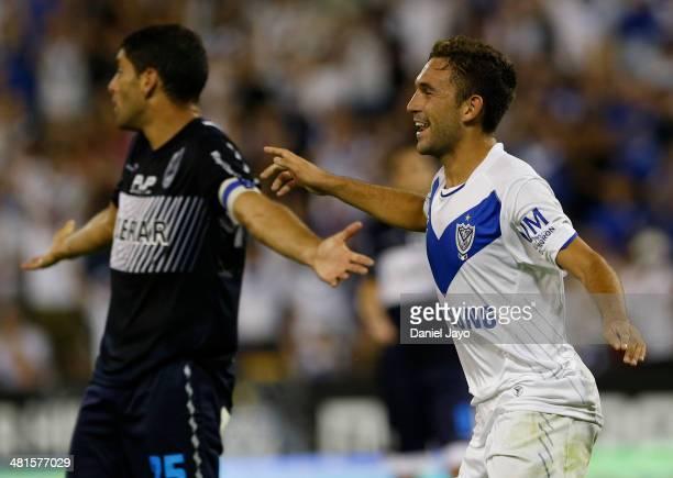 Agustin Allione of Velez Sarsfield celebrates after scoring the third goal as Ignacio Jauregui of Gimnasia y Esgrima La Plata reacts during a match...