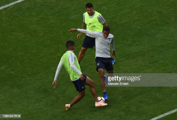 Agustin Almendra fights for the ball with teammate Wilmar Barrios of Boca Juniors during an open training session ahead of the final match of Copa...