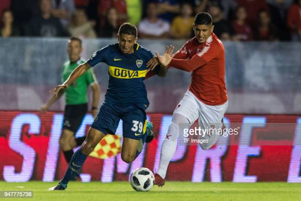 Agustin Almendra of Boca Juniors and Alan Franco of Independiente battle for the ball during a match between Independiente and Boca Juniors as part...