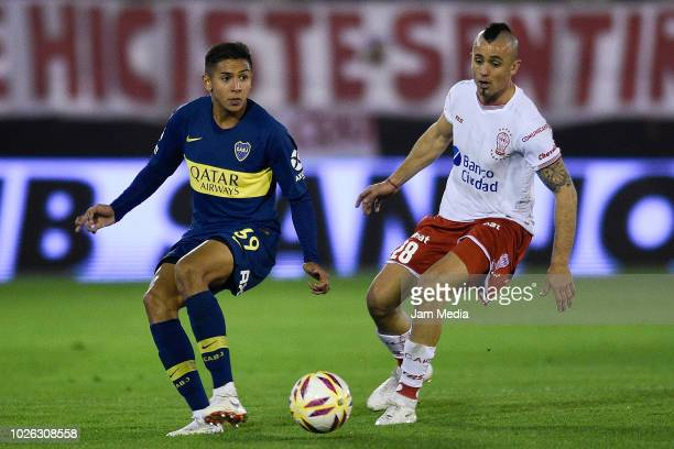Agustin Almendra of Boca Juniors and Cristian Chimino of Huracan fights for the ball during a match between Huracan and Boca Juniors as part of...