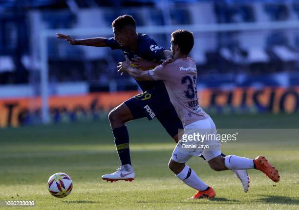 Agustin Almendra of Boca Juniors and Matias Melluso of Gimnasia y Esgrima La Plata vie for the ball during a match between Gimnasia y Esgrima La...