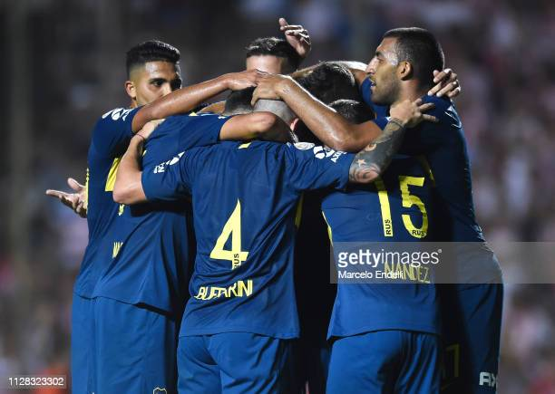 Agustin Almendra of Boca Juniors celebrates with teammates after scoring the third goal of his team during a match between Union and Boca Juniors as...