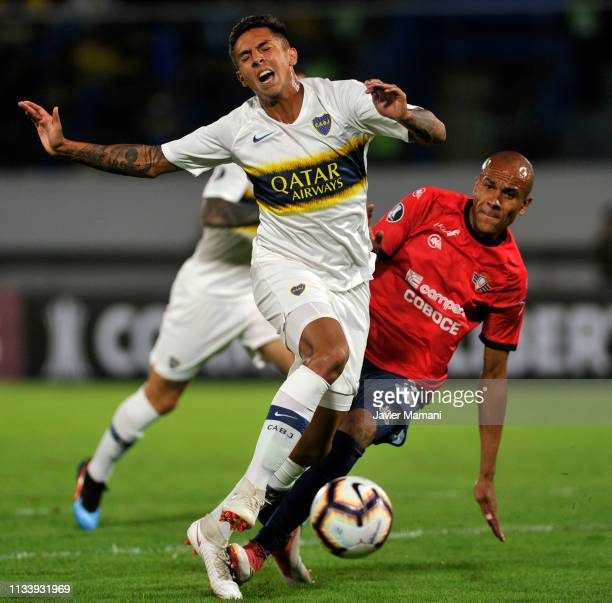 Agustin Almendra of Boca Juniors competes for the ball with Alex Silva of Wilstermann during a group G match between Jorge Wilstermann and Boca...