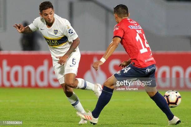 Agustin Almendra of Boca Juniors competes for the ball with Jorge Ortíz of Wilstermann during a group G match between Jorge Wilstermann and Boca...