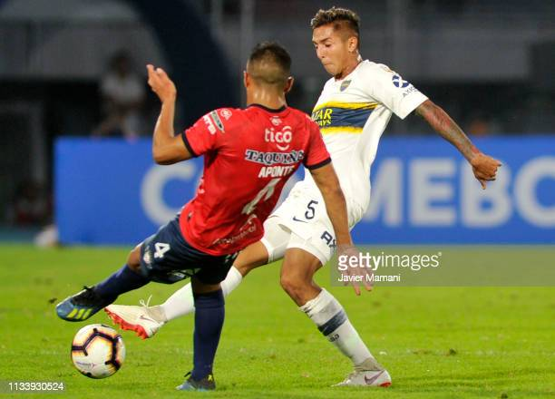 Agustin Almendra of Boca Juniors competes for the ball with Juan Pablo Aponte of Wilstermann during a group G match between Jorge Wilstermann and...