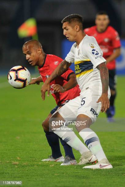 Agustin Almendra of Boca Juniors competes for the ball with Serginho of Wilstermann during a group G match between Jorge Wilstermann and Boca Juniors...
