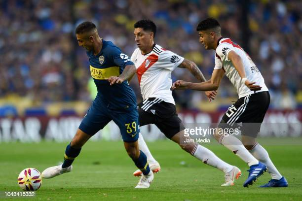 Agustin Almendra of Boca Juniors controls the ball under pressure of Enzo Perez and Exequiel Palacios of River Plate during a match between Boca...