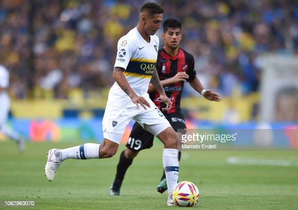 Agustin Almendra of Boca Juniors drives the ball against Santiago Briñone of Patronato during a match between Boca Juniors and Patronato as part of...