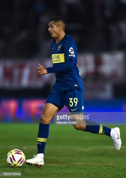 Agustin Almendra of Boca Juniors drives the ball during a match between Huracan and Boca Juniors as part of Superliga Argentina 2018/19 at Estadio...