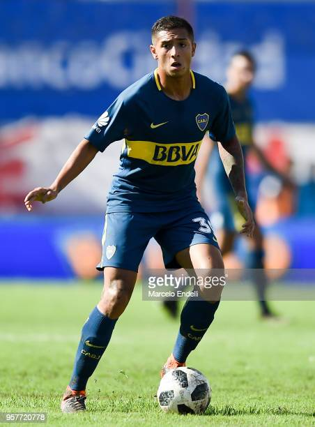 Agustin Almendra of Boca Juniors drives the ball during a match between Huracan and Boca Juniors as part of Superliga 2017/18 at Estadio Tomas Adolfo...
