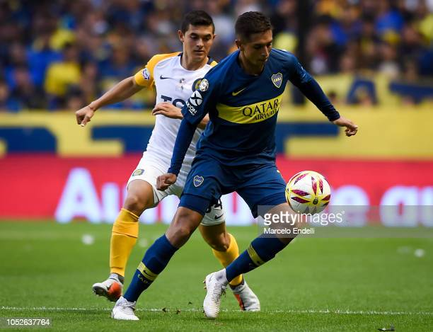 Agustin Almendra of Boca Juniors drives the ball during a match between Boca Juniors and Rosario Central as part of Superliga 2018/19 at Alberto J...