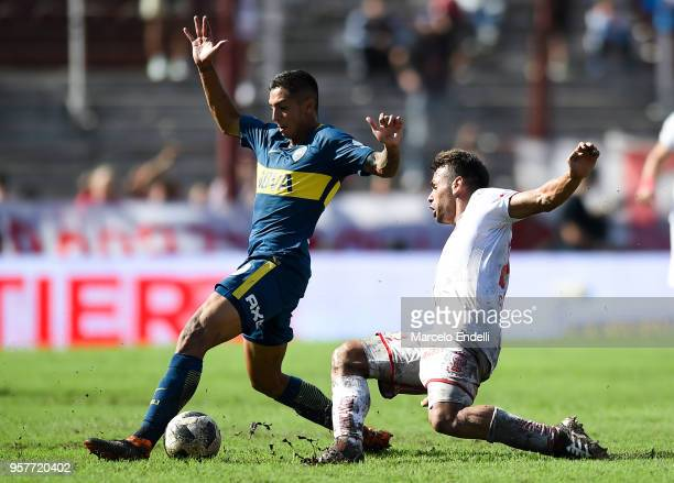 Agustin Almendra of Boca Juniors fights for the ball with Adrian Calello of Huracan during a match between Huracan and Boca Juniors as part of...