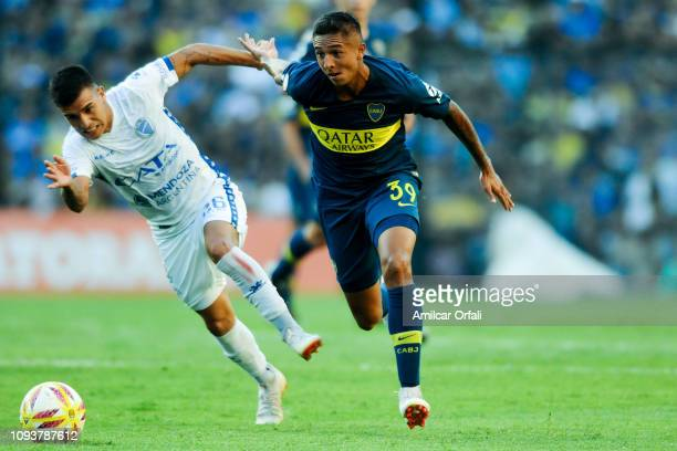 Agustin Almendra of Boca Juniors fights for the ball with Agustin Verdugo of Godoy Cruz during a match between Boca Juniors and Godoy Cruz as part of...