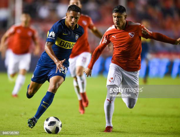 Agustin Almendra of Boca Juniors fights for the ball with Alan Franco of Independiente during a match between Independiente and Boca Juniors as part...