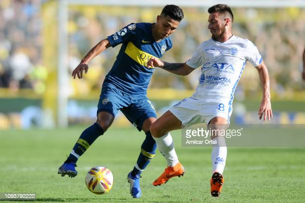 Agustin Almendra of Boca Juniors fights for the ball with Angel Gonzalez of Godoy Cruz during a match between Boca Juniors and Godoy Cruz as part of...