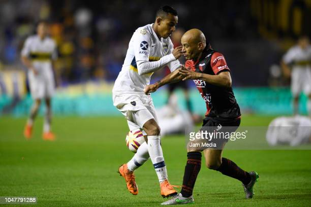 Agustin Almendra of Boca Juniors fights for the ball with Clemente Rodriguez of Colon during a match between Boca Juniors and Colon as part of...