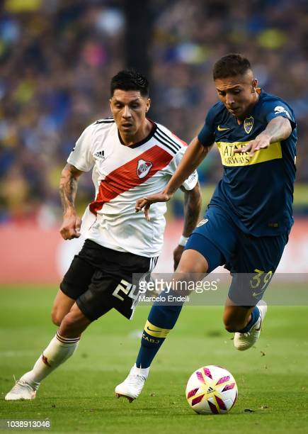 Agustin Almendra of Boca Juniors fights for the ball with Enzo Perez of River Plate during a match between Boca Juniors and River Plate as part of...