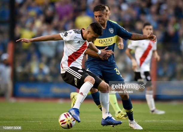 Agustin Almendra of Boca Juniors fights for the ball with Exequiel Palacios of River Plate during a match between Boca Juniors and River Plate as...