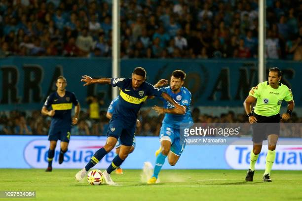 Agustin Almendra of Boca Juniors fights for the ball with Federio Lertora of Belgrano during a match between Belgrano and Boca Juniors as part of...