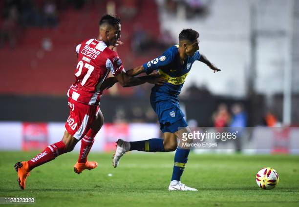Agustin Almendra of Boca Juniors fights for the ball with Javier Mendez of Union during a match between Union and Boca Juniors as part of Superliga...