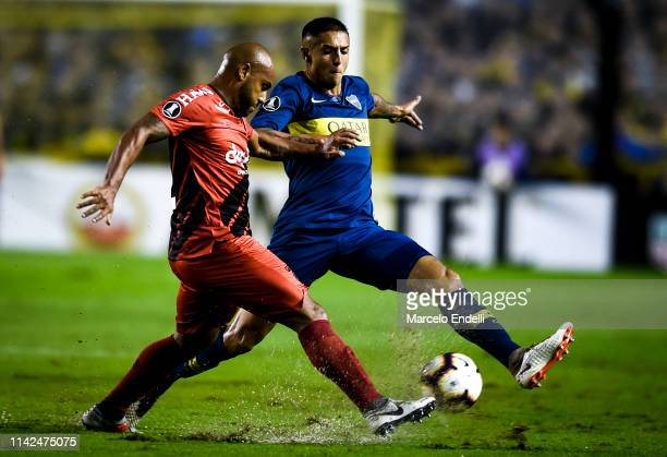 Agustin Almendra of Boca Juniors fights for the ball with Jonathan of Atletico Paranaense during a group G match between Boca Juniors and Atletico...