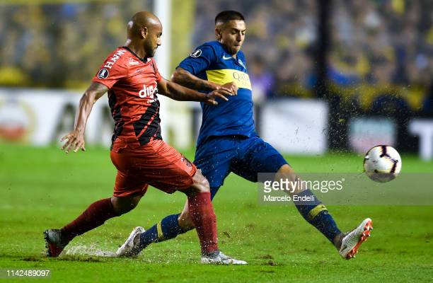 Agustin Almendra of Boca Juniors fights for the ball with Jonathan of Atletico Paranaense during a group G match between Boca Junrios and Atletico...