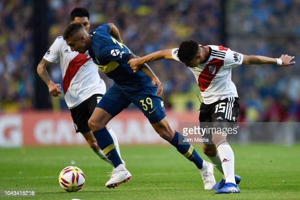 Agustin Almendra of Boca Juniors figths for the ball with Exequiel Palacios of River Plate during a match between Boca Juniors and River Plate as...