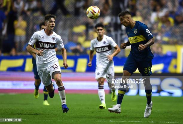Agustin Almendra of Boca Juniors heads the ball during a match between Boca Juniors and Lanus as part of Superliga 2018/19 at Estadio Alberto J...