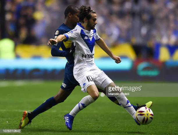 Agustin Bouzat of Velez Sarsfield fights for the ball with Wilmar Barrios of Boca Juniors during a match between Boca Juniors and Velez as part of...