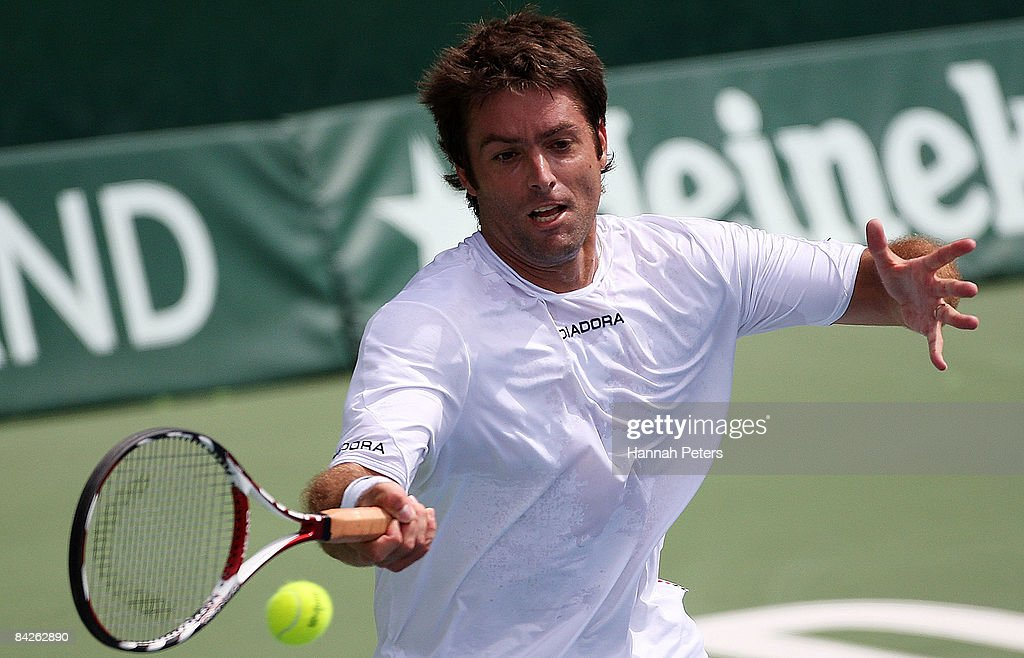Agustin Calleri of Argentina plays a forehand during his first round match against Marc Gicquel of France during day two of the Heineken Open at ASB Tennis Centre on January 13, 2009 in Auckland, New Zealand.