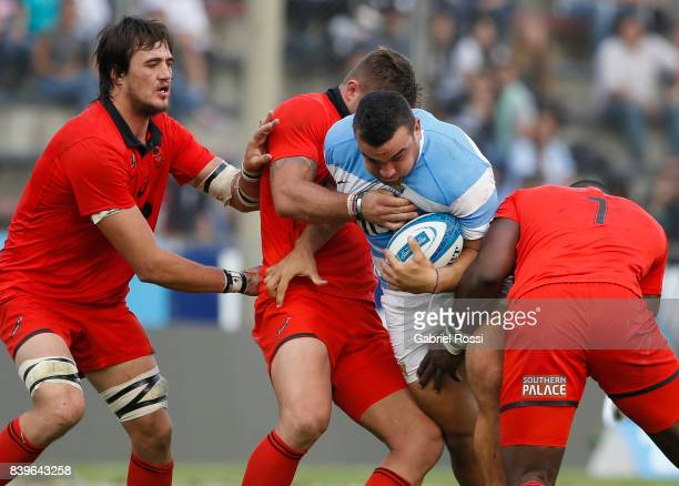 Agustin Creevy of Argentina is tackled by Jaco Kriel of South Africa during the round two match between Argentina and South Africa as part of The...