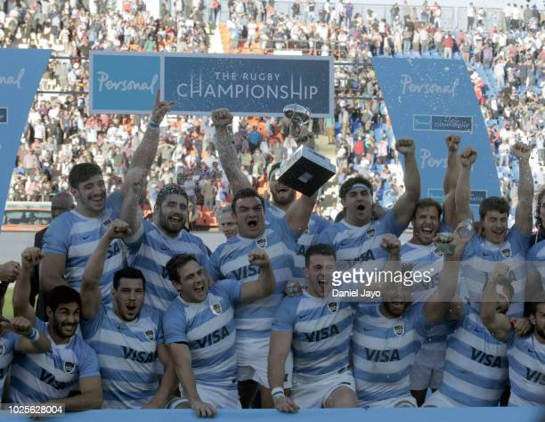 Agustin Creevy of Argentina lifts the trophy at the end of a match between Argentina and South Africa as part of The Rugby Championship 2018 at...