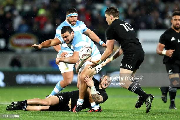 Agustin Creevy ofg Argentina is tackled during The Rugby Championship match between the New Zealand All Blacks and Argentina at Yarrow Stadium on...
