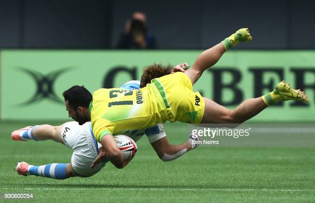 Agustin Della Corte of Uruguay tackles Brandon Quinn of Australia during the Canada Sevens the Sixth round of the HSBC Sevens World Series at the BC...