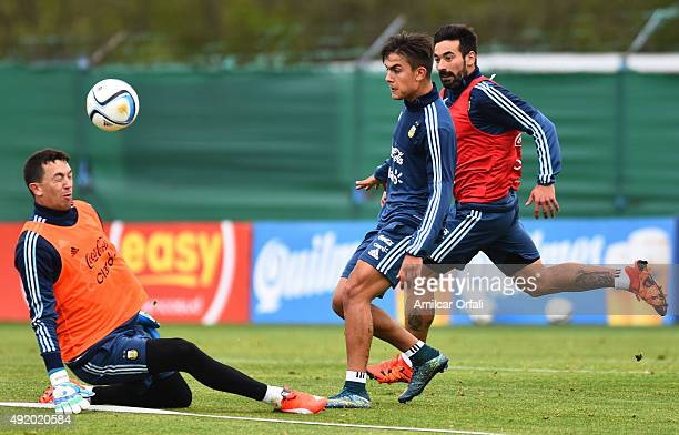 Agustin Marchesin and Paulo Dybala of Argentina fight for the ball during a training session on October 09 2015 in Ezeiza Argentina Argentina will...