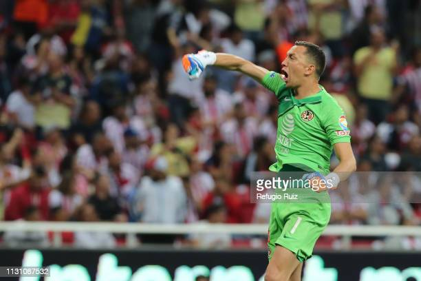 Agustin Marchesin goalkeeper of America celebrates his team's first goal during the 11th round match between Chivas and America as part of the Torneo...