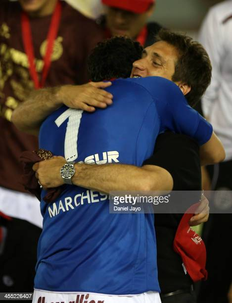 Agustin Marchesin goalkeeper of Lanus celebrates with Guillermo Barros Schelotto coach of Lanus at the end of the final match between Lanus and Ponte...