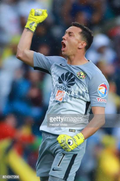 Agustin Marchesin of America celebrates the first goal of his team scored by his teammate Cecilio Domínguez during the 2nd round match between...