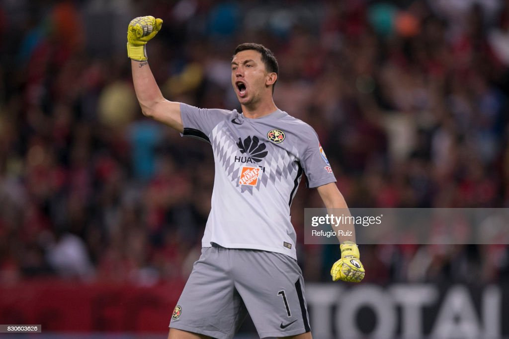 Agustin Marchesin of America, celebrates the first goal of his team scored by his teammate Oribe Peralta (Not in Frame) during the 4th round match between Atlas and America as part of the Torneo Apertura 2017 Liga MX at Jalisco Stadium on August 11, 2017 in Guadalajara, Mexico.