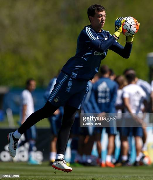 Agustin Marchesin of Argentina catches the ball during a training session at Argentine Football Association 'Julio Humberto Grondona' training camp...