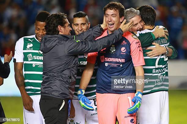 Agustin Marchesin of Santos Laguna celebrates with Alejandro Irarragorri President of Santos after a championship second leg match between Queretaro...