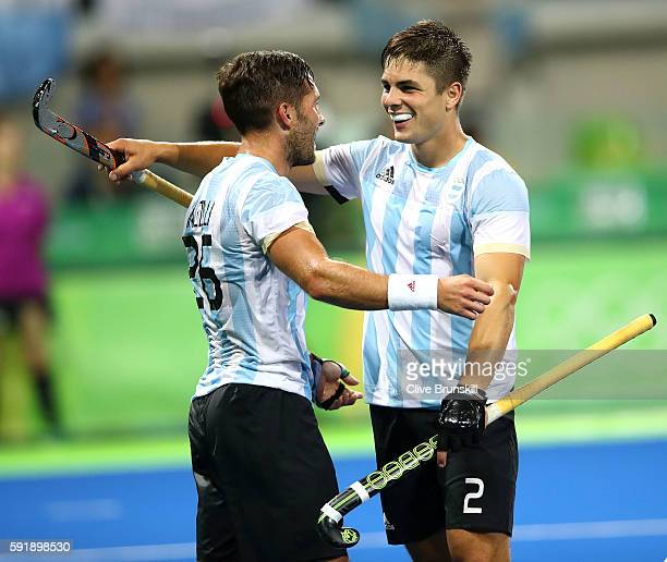 Agustin Mazzilli of Argentina and Gonzalo Peillat of Argentina celebrate winning in the Men's Hockey Gold Medal match between Belgium and Argentina...