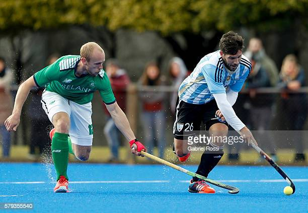 Agustin Mazzilli of Argentina fights for the ball with Eugene Magee of Ireland during an International Friendly match between Argentina and Ireland...