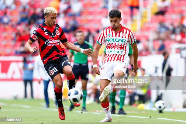 Agustin Oliveros # of Necaxa competes for the ball with Lucas Rodriguez of Club Tijuana during the 11th round match between Necaxa and Club Tijuana...