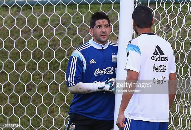 Agustin Orion and Sergio Romero of Argentina during a training session at Cidade do Galo on June 26 2014 in Vespasiano Brazil