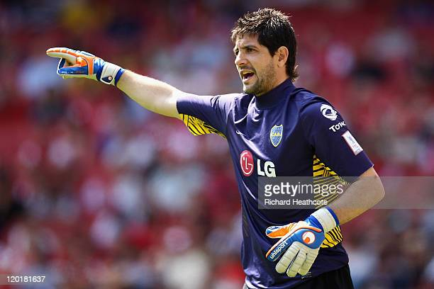 Agustin Orion of Boca Juniors directs his defence during the Emirates Cup match between Boca Juniors and Paris St Germain at the Emirates Stadium on...