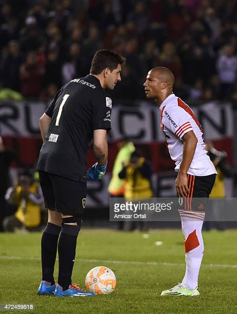 Agustin Orion of Boca Juniors talks to Carlos Sanchez of River Plate during a first leg match between River Plate and Boca Juniors as part of round...